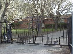 Custom iron gate with arch and 1/2